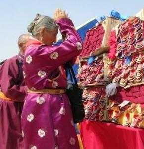 Dornogov -- Shambhala -- First Anniversary -- Old Woman in Purple Worshiping Texts -- WS